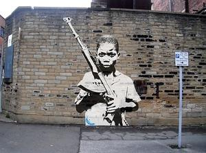 kid-with-gun-on-wall-a3-print
